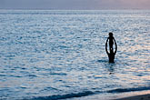 horizontal stock photography | Fiji, Child standing in shoulders in ocean, image id 5-610-9327