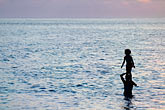 children swimming stock photography | Fiji, Viti Levu, Standing on shoulders, image id 5-610-9330