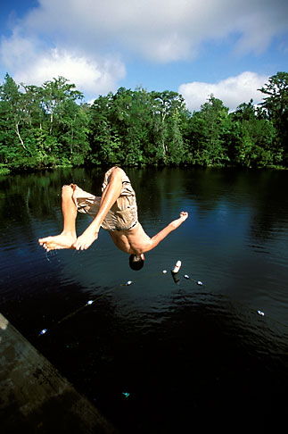 image 2-530-26 Florida, Tallahassee area, Wakulla Springs State Park, boy dong a backflip