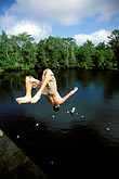 active stock photography | Florida, Tallahassee area, Wakulla Springs State Park, boy dong a backflip, image id 2-530-26