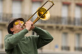 horizontal stock photography | France, Paris, Street band trombone player, image id 6-450-5790