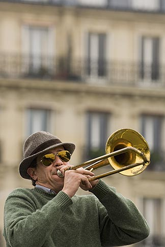 image 6-450-5800 France, Paris, Street band trombone player