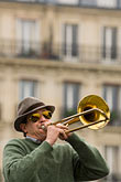 play stock photography | France, Paris, Street band trombone player, image id 6-450-5800