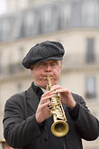 play stock photography | France, Paris, Street band soprano sax player, image id 6-450-5807