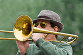 horizontal stock photography | France, Paris, Street band trombone player, image id 6-450-5810
