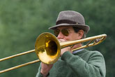 horizontal stock photography | France, Paris, Street band trombone player, image id 6-450-5816