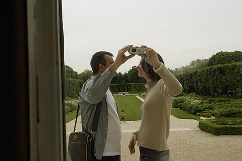 image 6-450-6666 France, Paris, Rodin Museum, Couple taking photos