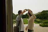 horizontal stock photography | France, Paris, Rodin Museum, Couple taking photos, image id 6-450-6666