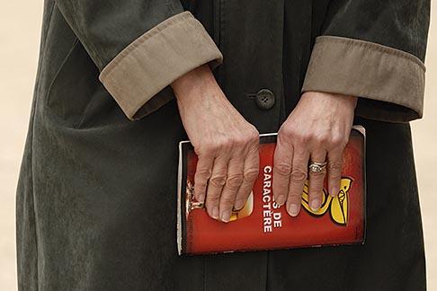 image 6-450-698 France, Paris, Woman holding book