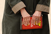 hands on stock photography | France, Paris, Woman holding book, image id 6-450-698