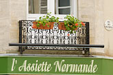 wrought iron balcony stock photography | France, Normandy, Bayeux, Balcony and flowers, image id 6-450-892