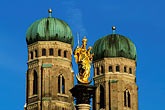timepiece stock photography | Germany, Munich, Frauenkirche towers and Mariensaule (St Mary