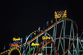 midway stock photography | Germany, Munich, Oktoberfest, Roller Coaster at night, image id 3-952-38