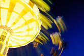 ferris wheel at night stock photography | Germany, Munich, Oktoberfest, Fairgrounds at night, image id 3-952-79
