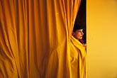 curtain stock photography | Germany, Munich, Oktoberfest, Woman off stage in variety show, image id 3-954-43