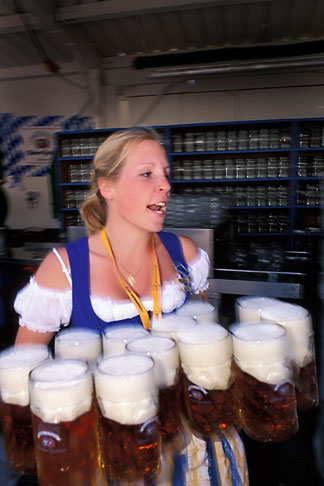 image 3-955-12 Germany, Munich, Oktoberfest, Waitress with beers
