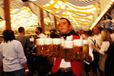 motion stock photography | Germany, Munich, Oktoberfest, Waiter with beers, image id 3-955-81