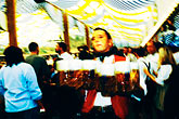 motion stock photography | Germany, Munich, Oktoberfest, Waiter with beers, image id 3-955-999