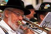 hat stock photography | Germany, Munich, Oktoberfest, Band concert trombone player, image id 3-956-54