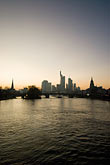 city skyline at sunset stock photography | German, Frankfurt, City skyline with Main River at sunset, image id 8-710-1409
