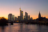 city skyline at sunset stock photography | German, Frankfurt, City skyline with Main River at sunset, image id 8-710-1416