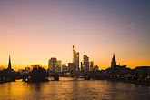 city skyline at sunset stock photography | German, Frankfurt, City skyline with Main River at sunset, image id 8-710-178