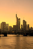city skyline at sunset stock photography | Germany, Frankfurt, City skyline with Main River at sunset, image id 8-711-1