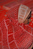 cloth stock photography | India, Goa, Woman vendor, Anjuna flea market, image id 0-609-12