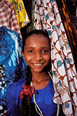 fabrics in bazaar stock photography | India, Goa, Young girl in shop, Colva, image id 0-612-2