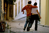 party stock photography | Greece, Athens, Anafiotika, Couple in street, image id 3-654-7