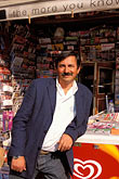 toil stock photography | Greece, Athens, Kolonaki, Newsstand owner, image id 3-654-90
