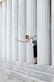 greece stock photography | Greece, Woman leaning out from portico of Greek columns, image id 7-640-5015
