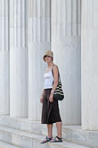 hat stock photography | Greece, Woman with hat standing with Greek columns, image id 7-640-5017
