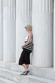 greece stock photography | Greece, Woman with hat, leaning on Greek columns, image id 7-640-5018