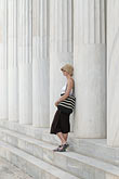 greece stock photography | Greece, Woman with hat, leaning on Greek columns, image id 7-640-5021