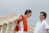 standing amid ruins stock photography | Greece, Couple in white, standing amid ruins, image id 7-640-5427