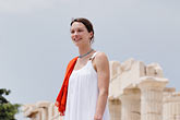 white dress stock photography | Greece, Woman in white dress with red shawl, image id 7-640-5436