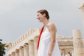 woman stock photography | Greece, Woman in white dress with red shawl, image id 7-640-5444