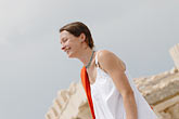 white dress stock photography | Greece, Woman in white dress with red shawl, image id 7-640-5446