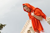 white dress stock photography | Greece, Woman in white dress with red shawl, image id 7-640-5456