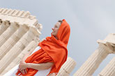 white dress stock photography | Greece, Woman in white dress with red shawl, image id 7-640-5460