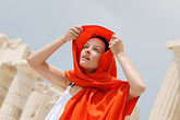 white dress stock photography | Greece, Woman in white dress with red shawl, image id 7-640-5464
