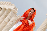 white dress stock photography | Greece, Woman in white dress with red shawl, image id 7-640-5470