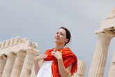 white dress stock photography | Greece, Woman in white dress with red shawl, image id 7-640-5474
