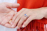 image 7-640-668 Portraits, Couple holding hands, closeup with wedding rings