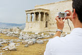 tourist photographing the porch of the caryatids stock photography | Greece, Athens, Acropolis, Tourist photographing the Porch of the Caryatids, Erectheion, image id 7-640-695