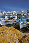 sunlight stock photography | Greece, Mykonos, Boats and fishing nets in harbor, image id 9-260-79