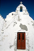 whitewashed building stock photography | Greece, Mykonos, Church of Panagia Paraportiana, image id 9-261-51