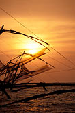 chinese fishing nets at sunset stock photography | India, Cochin, Chinese fishing nets at sunset, image id 7-101-17