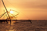 chinese fishing nets at sunset stock photography | India, Cochin, Chinese fishing nets at sunset, image id 7-101-3